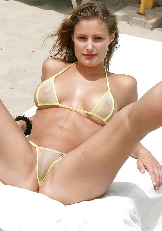 spread eagle see through bikini on the beach