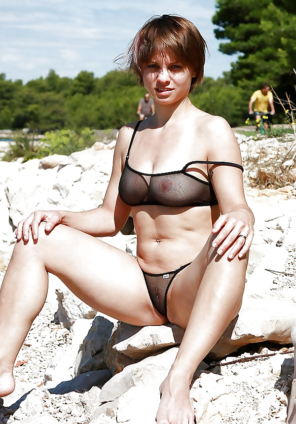 chubby fat titted girl wears see through bikini to the beach.