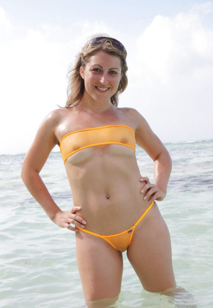 small tits at the beach exposing tits and pussy.