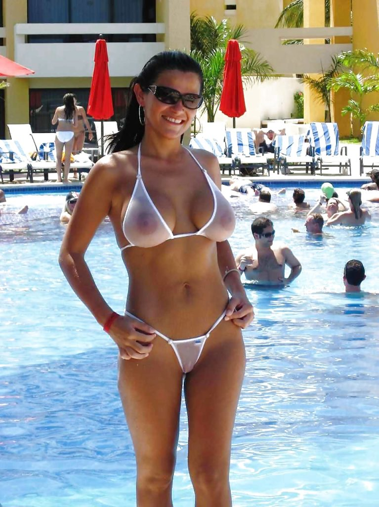 milf at the pool in a sheer bikini in front of families