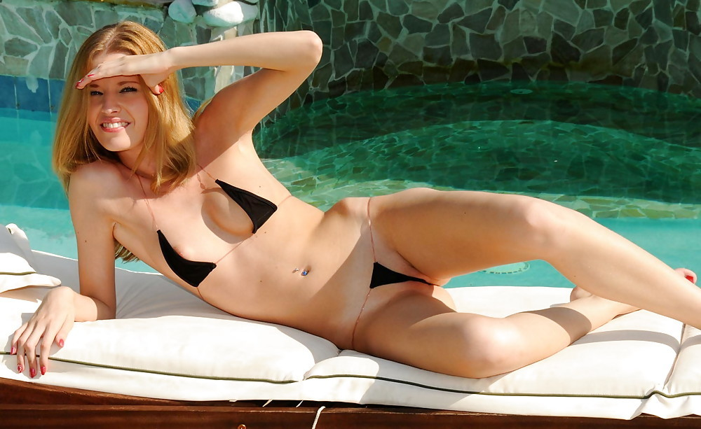 cute ginger in a skimpy bikini by the pool