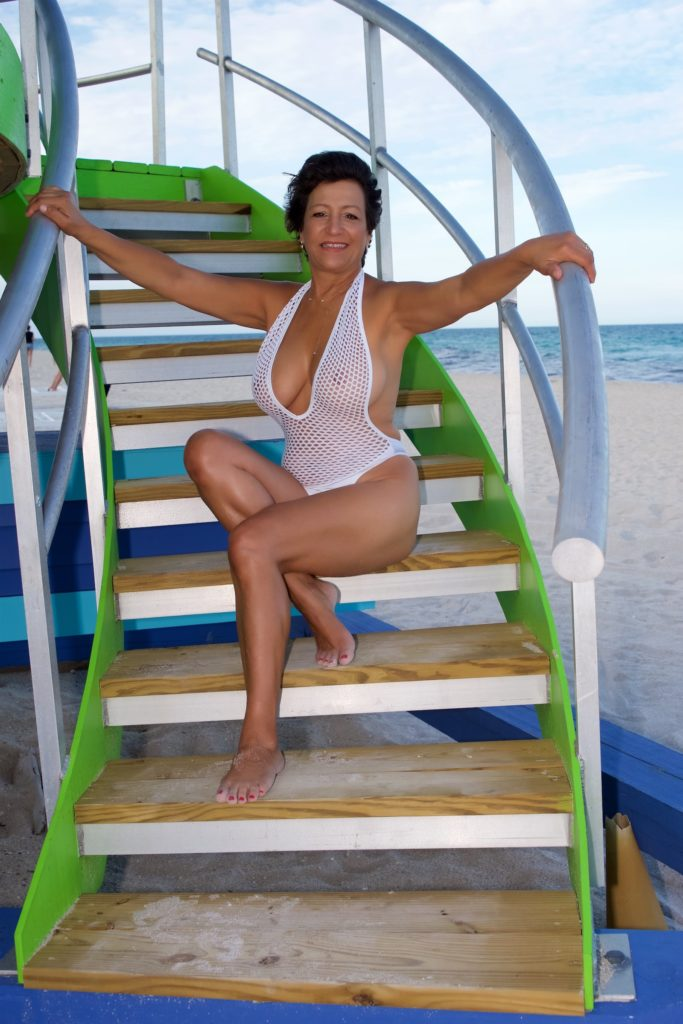 milf in mesh one piece on stairs