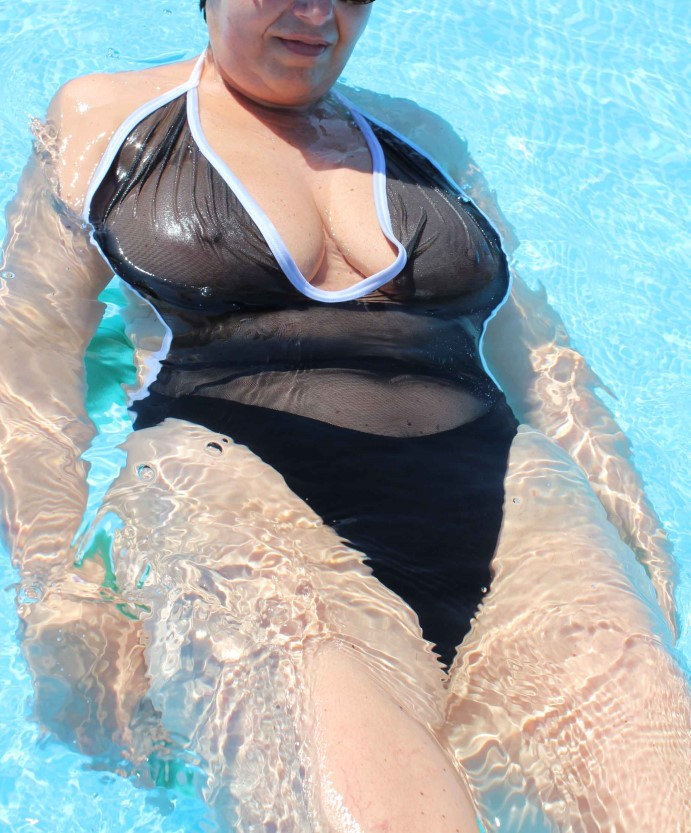 annoyed milf in see through one piece with tits exposed