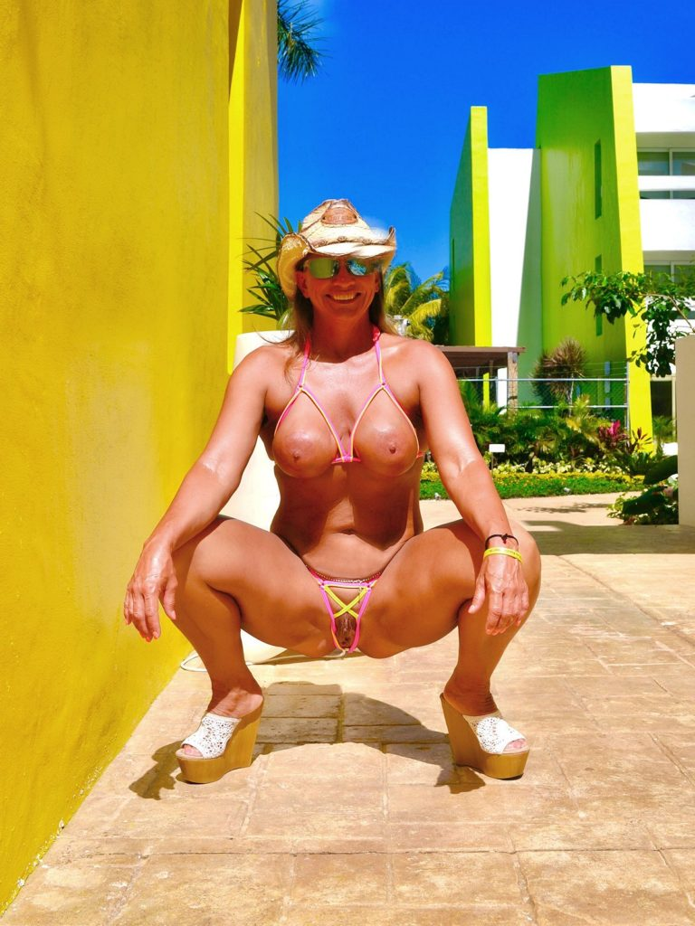 milf cowgirl goes to the beach with a crotchless bikini and a butt plug [gallery]. 1