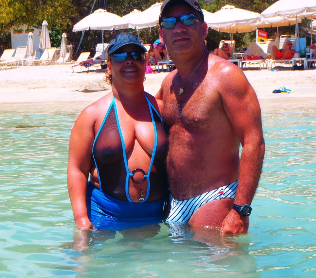 chubby mom on the beach in a see through one piece