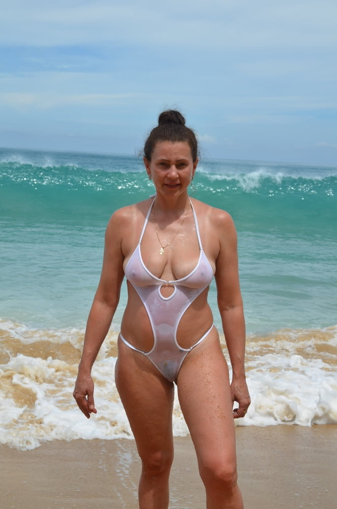 thicc milf in see through one piece