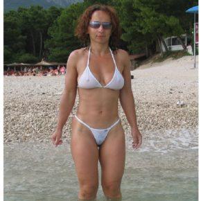 mom on public beach with see through bikini