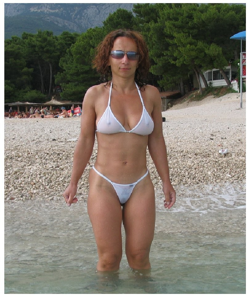 mom on beach with see through bikini