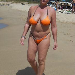 milf with huge tits in skimpy bikini