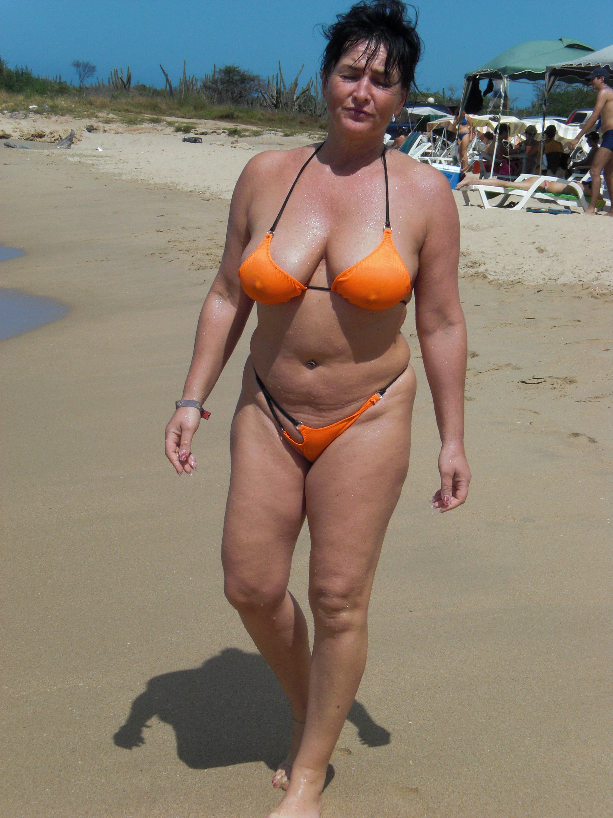 milf with huge tits in skimpy bikini