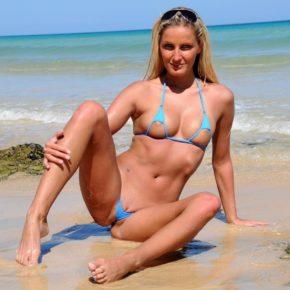 hot milf in extreme bikini at the beach.