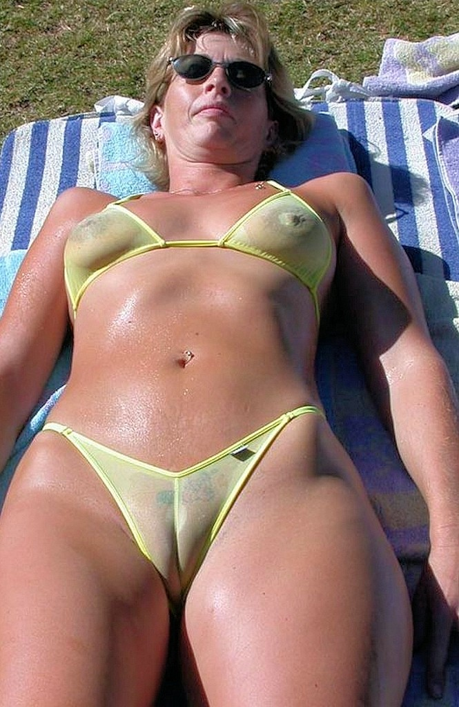 milf in sheer bikini with a fat cameltoe