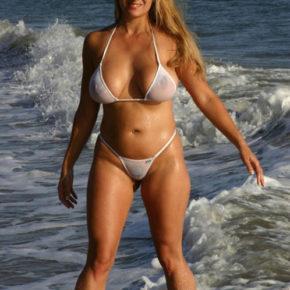 young big tits in a sheer bikini in public