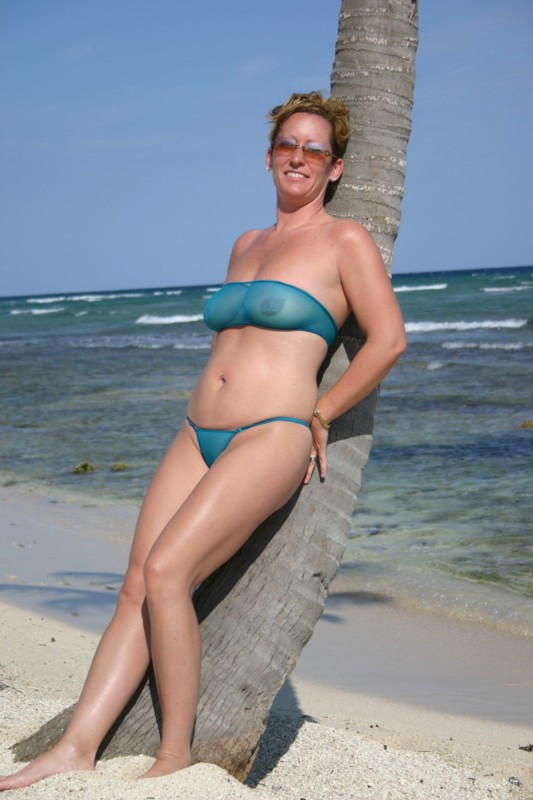 milf in completely sheer bikini in public