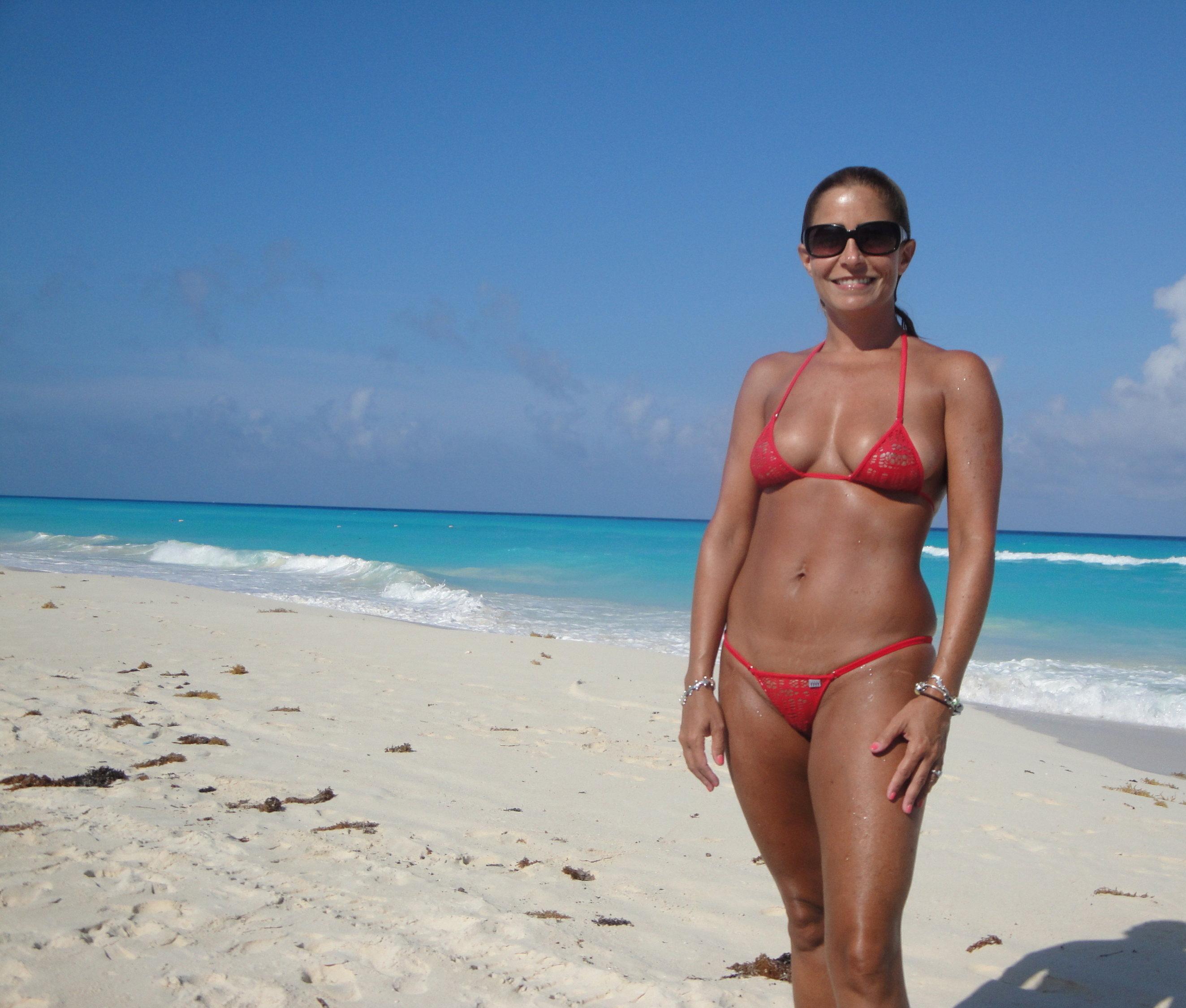 fit milf in see through bikini on a public beach