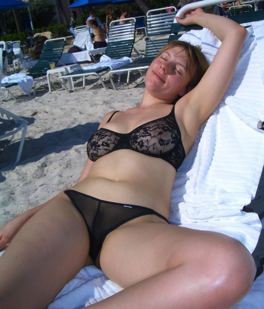 girlfriend in sheer bikini on public beach