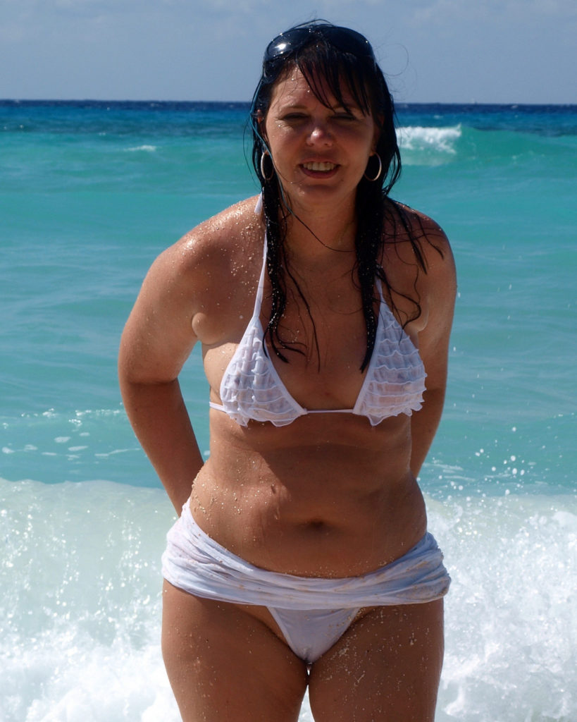 chubby milf in see through top at the beach