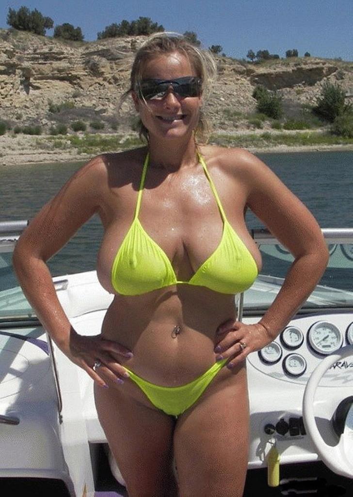 big titted milf on a boat in a sheer bikini