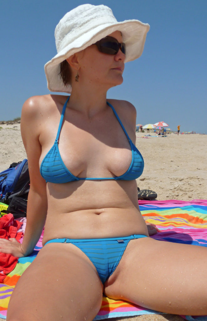milf with big tits in a sheer bikini