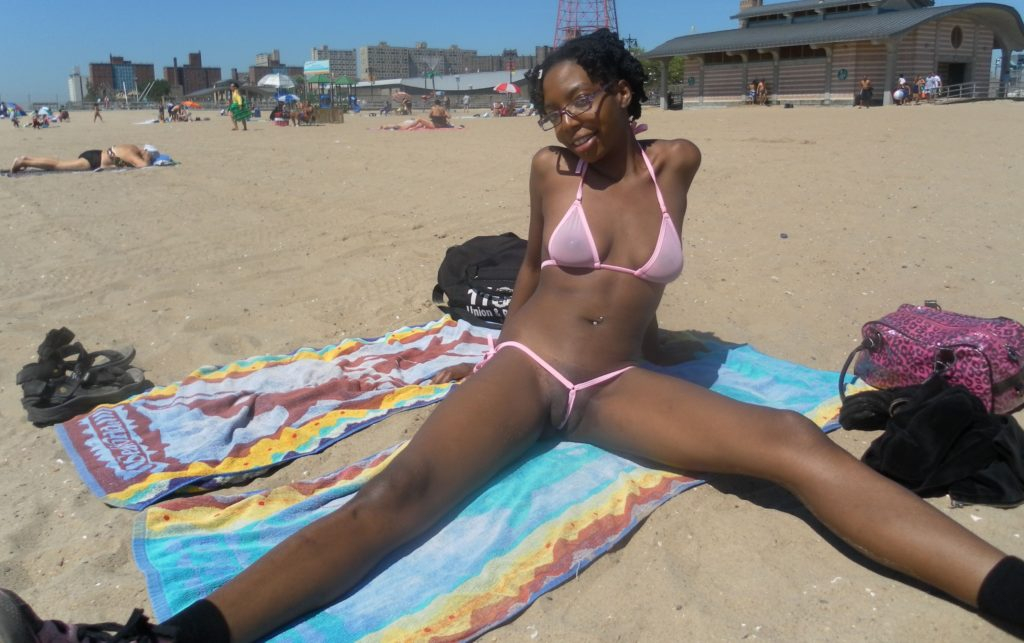 cute ebony girl in see through clit bikini in public