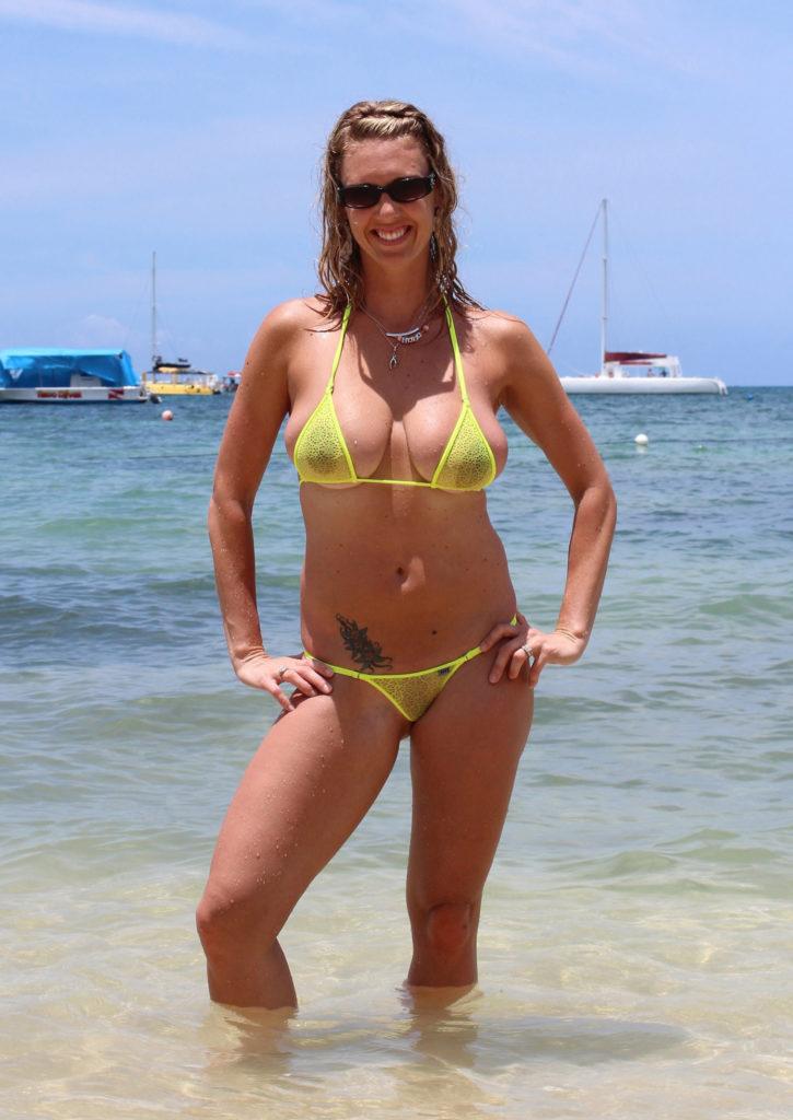 milf in see through bikini at the beach.