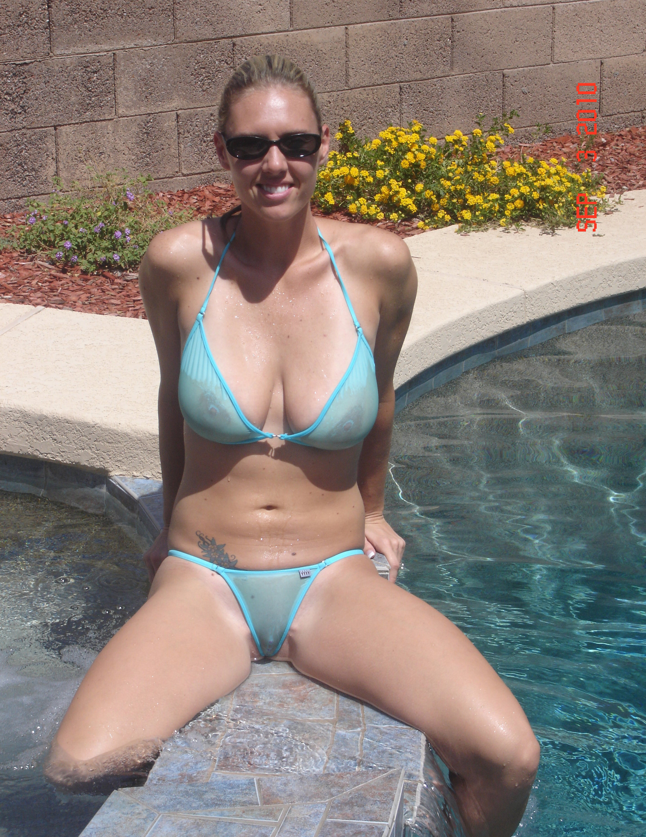 milf in see through bikini at a resort in public. [gallery]