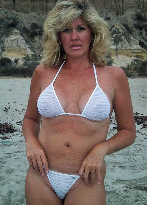 milf in naughty see through top at the beach