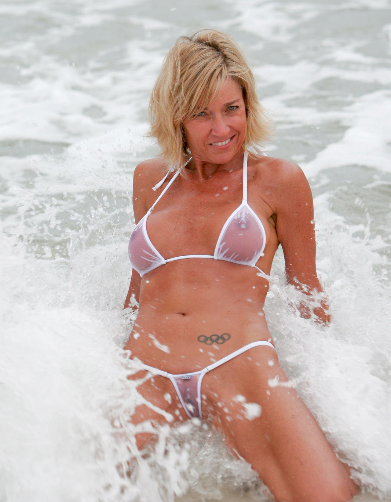 milf wet in a see through bikini at the beach