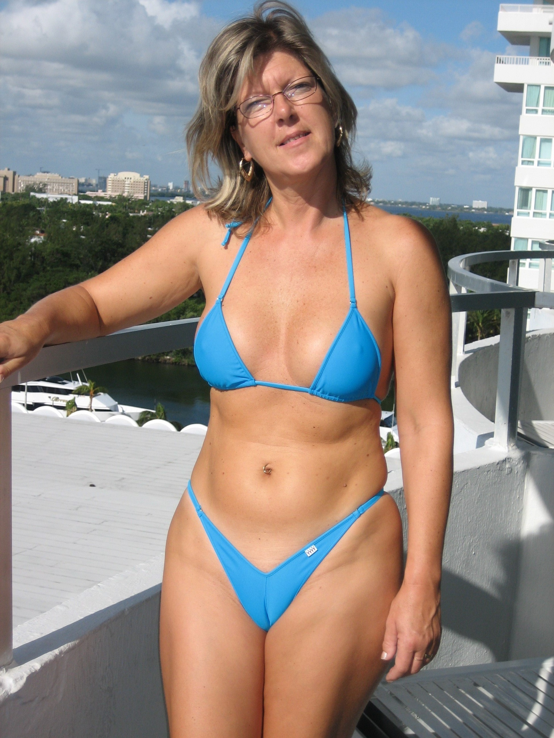 milf with glasses in a skimpy little bikini