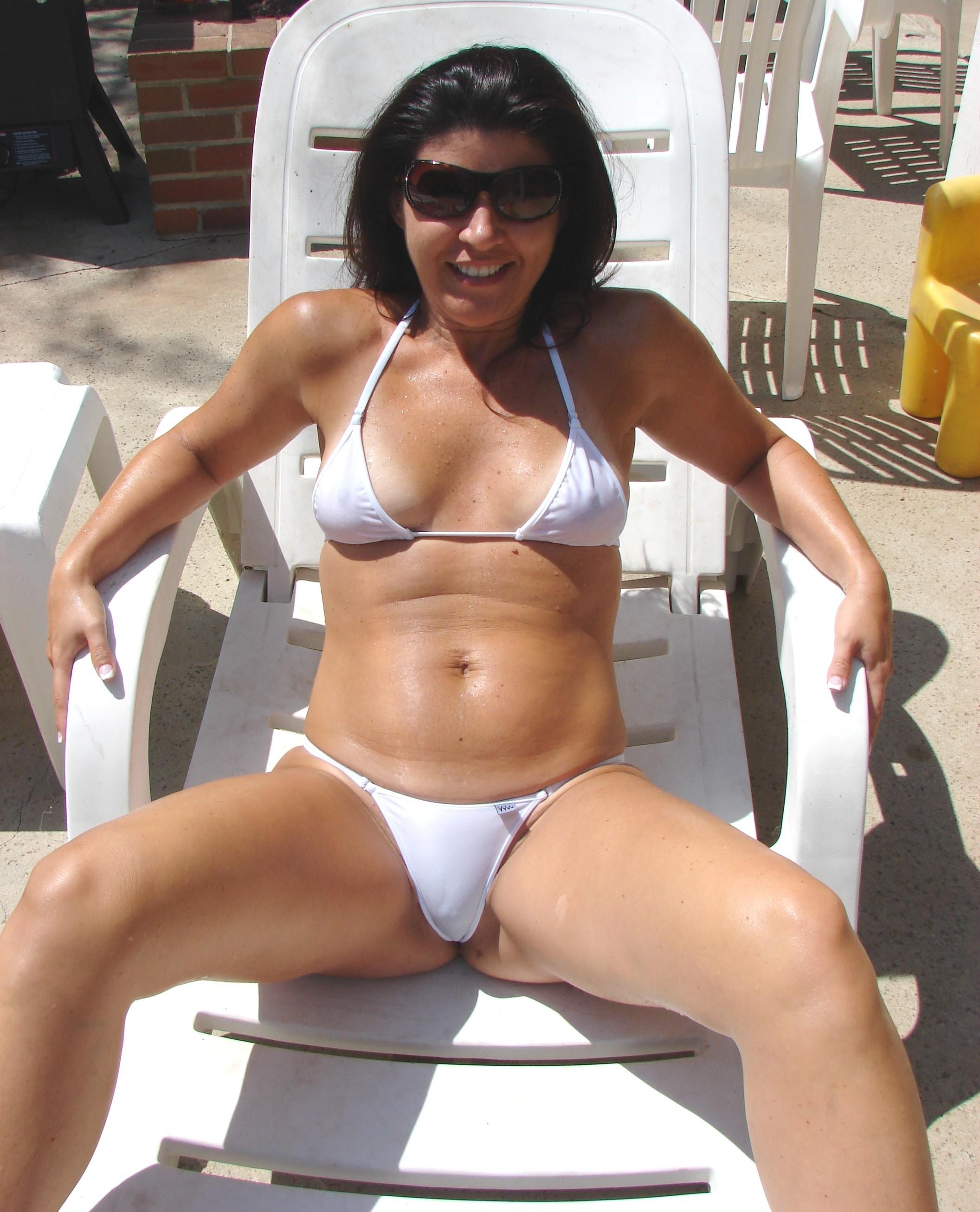 milf spread eagle by the pool in a seethrough bikini