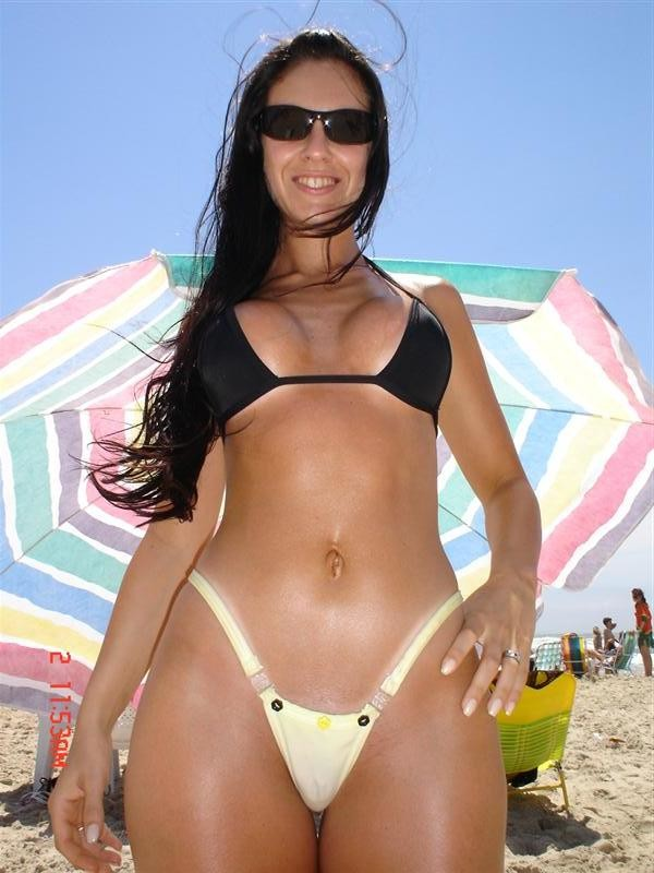 hot wife with a cameltoe at the beach.