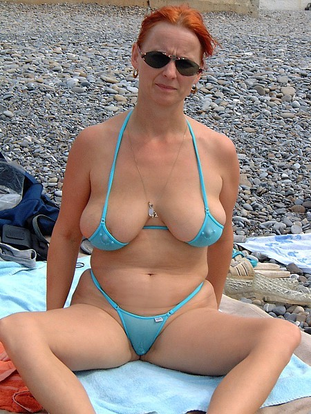 milf spread eagles with saggy tits at the beach
