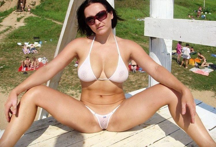 girl spread eagles in a see through bikini