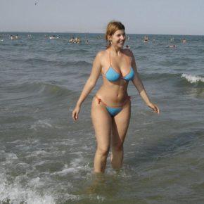 thicc girl on the beach in a skimpy see through bikini