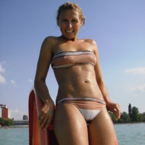 fit milf doesn't realize her bikini is letting everyone see her pussy and tits