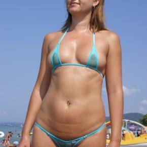 milf in see though micro bikini on a public beach