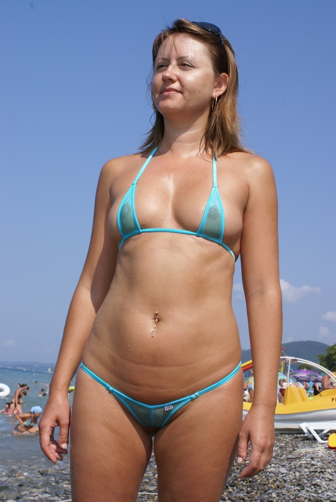 milf in see though micro bikini on a public beach