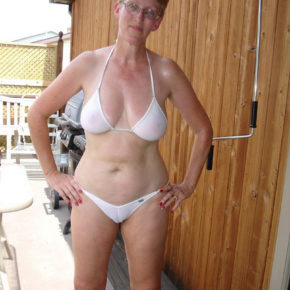 mom in the backyard in a see through bikini, getting ready to entertain guests.