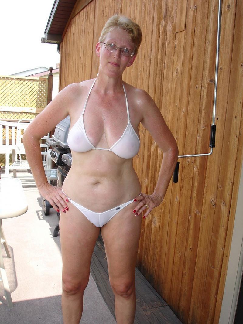 milf in public at the pool in a see through bikini