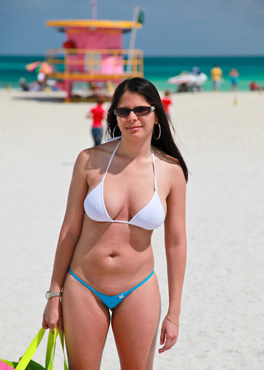 milf in a see through bikini on a public beach