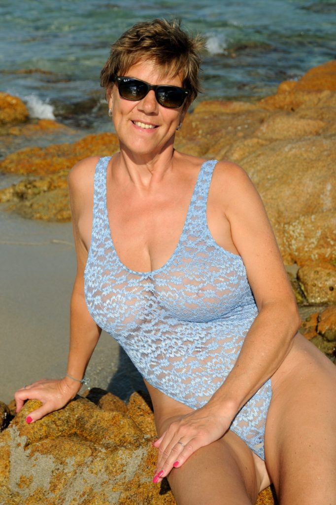 milf with huge tits in see through one piece