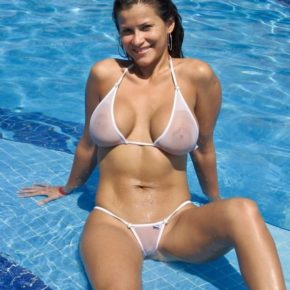 sexy big tits milf in a sheer extreme bikini at the pool