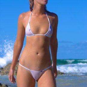 fit girl on the beach in a revealing bikini
