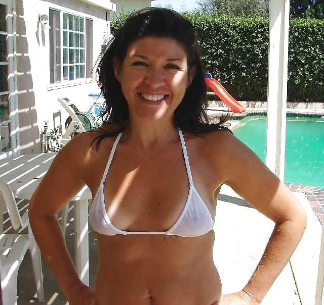 smiling mom in the backyard in see through bikini