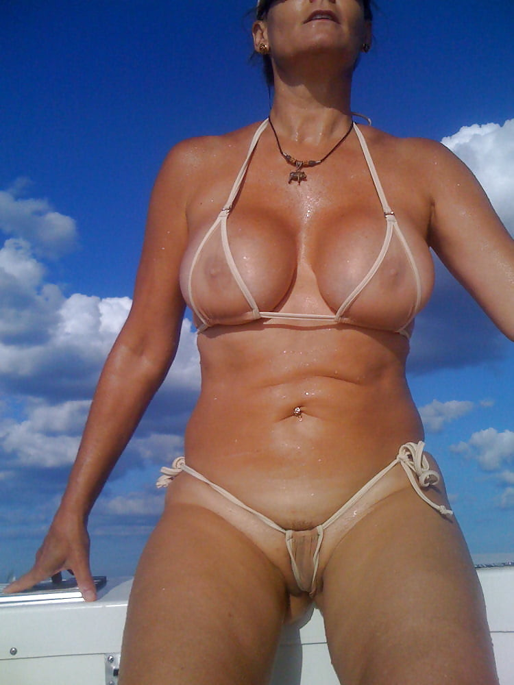 mom in a very see through bathing suit