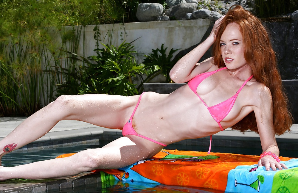 cute red head in a microkini