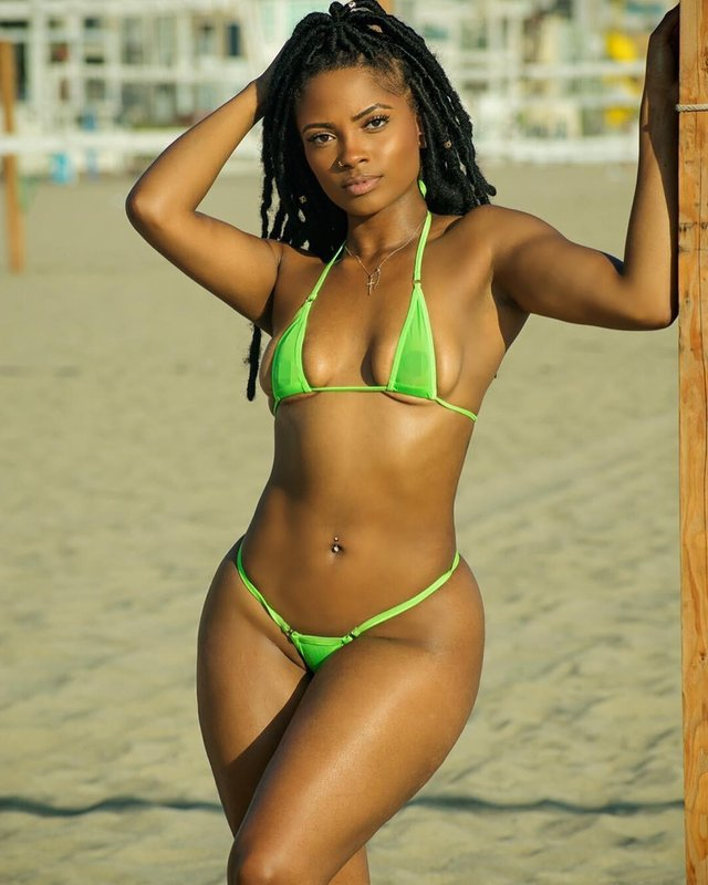ebony girl in a see through skimpy bikini
