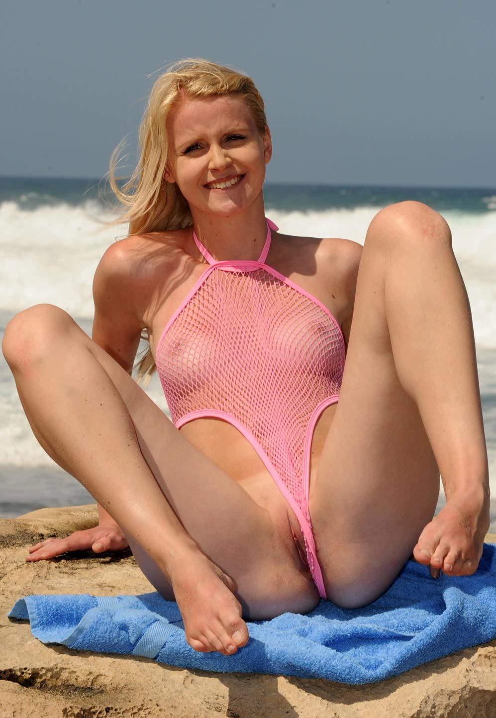 milf in mesh one piece flashing her cute little pussy.