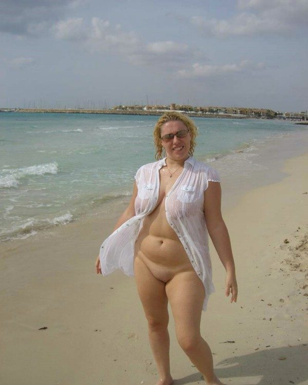 mom in the beach in sheer clothes