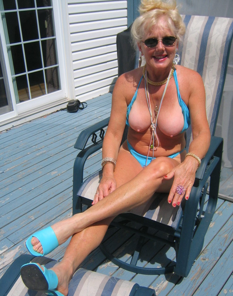 grandma in the backyard with her tits out